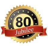 Bouton de jubilé avec des bannières - 80 ans Photo stock