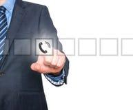 Bouton de téléphone de pressing d'homme d'affaires, écran visuel Photographie stock