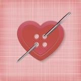 Bouton en forme de coeur avec une aiguille sur un fond rayé Photos libres de droits