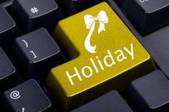 Bouton jaune de vacances sur le clavier Photographie stock