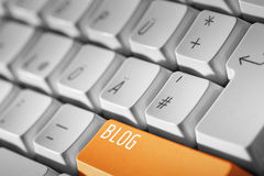 Bouton orange de blog sur le clavier Photographie stock libre de droits