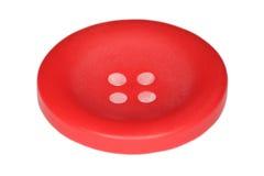 Bouton rouge pour des vêtements d'isolement sur le blanc Image libre de droits