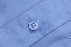 Bouton sur la chemise Image stock