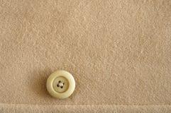 Bouton sur le tissu de laines Images stock