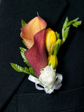 Boutonniere. Colorful wedding boutonniere on suit of groom stock photography