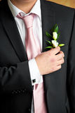 Boutonniere. The bridegroom corrects wedding boutonniere stock images