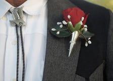 Boutonniere avec la cravate-ficelle photo libre de droits