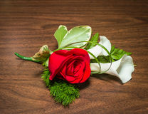 Boutonniere. Beautiful boutonniere with rose and callas on a table Stock Image