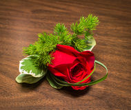 Boutonniere. Beautiful boutonniere with rose on a table stock photos