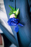 Boutonniere in blue. On wedding day royalty free stock images