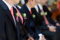 Boutonniere do casamento no revestimento do homem do noivo Fotos de Stock Royalty Free