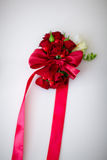 Boutonniere for the dressing on the arm. Stock Photo