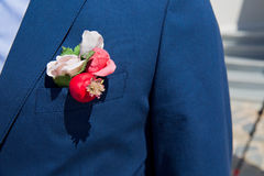 Boutonniere flower on jacket Royalty Free Stock Images