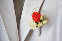 Boutonniere on grey suit Royalty Free Stock Images