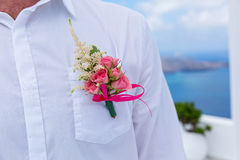Boutonniere of the groom. Boutonniere on white shirt of the groom royalty free stock images