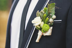 Boutonniere on his jacket Stock Photo