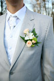 Boutonniere for jacket. The groom at a wedding ceremony. Boutonniere for jacket Royalty Free Stock Photo