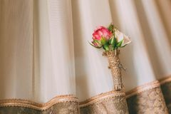 Boutonniere on a lace background. Close-up. Horizontal stock image