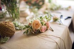 Boutonniere with natural flowers nonfinished Stock Image