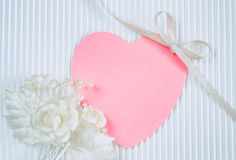 Boutonniere, pink heart shaped tag, white silk ribbon Stock Photography
