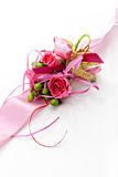 Boutonniere. Of pink roses on a pink ribbon on a white background royalty free stock photos