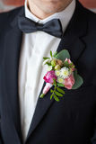 Boutonniere pinned on man in black suit Royalty Free Stock Photo