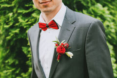 Boutonniere of red roses and white Stock Image