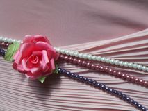 Boutonniere rose and a string of pearls Royalty Free Stock Image
