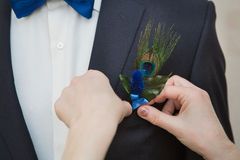 Boutonniere on trendy groom at wedding Royalty Free Stock Image