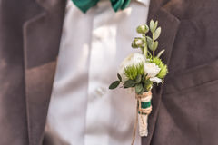 Boutonniere. Wedding boutonniere their flowers on the jacket of the groom Royalty Free Stock Photos