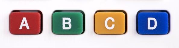 Boutons avec les lettres multicolores Images stock