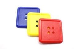 Boutons bleus de grand dos jaune et rouge Photographie stock libre de droits