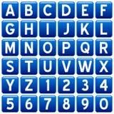 Boutons carrés bleus d'alphabet Photographie stock libre de droits