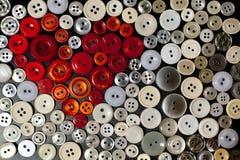 Boutons colorés dans la forme du coeur Photo libre de droits