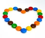Boutons color?s de chocolat photos stock