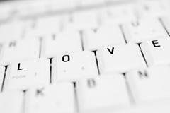 Boutons de clavier avec le mot AMOUR Photos libres de droits