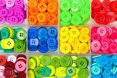 Boutons de couture dans une boîte Images libres de droits