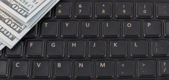 Boutons du clavier et de l'argent Photos stock