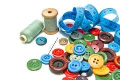 Boutons et bobines de fil Photographie stock