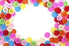Boutons multi de couleur sur le fond blanc Photographie stock