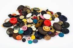 Boutons multicolores pour des vêtements Photos stock