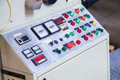 Boutons pour le contrôle de machines de production Photographie stock libre de droits