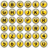 Boutons ronds jaunes d'alphabet Image stock