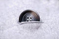 boutons sur le manteau gris Photographie stock libre de droits