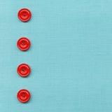 Boutons sur le tissu Photographie stock libre de droits