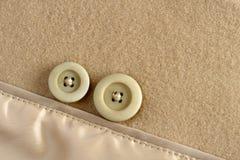 Boutons sur le tissu de laines Images stock