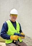 Bouw arbeider in veiligheidstoestel Stock Fotografie