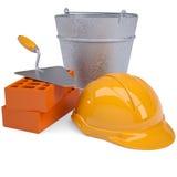 Bouw bakstenen, bouwvakker, troffel en een emmer Stock Afbeeldingen