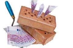 Bouw, financiering, hypotheekbanken. Baksteen royalty-vrije stock afbeelding