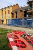 Bouw van nieuwe huizen met meer barier Royalty-vrije Stock Afbeeldingen